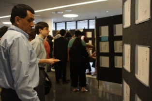 People looking at prized haiku exhibition