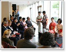 Ambassador and Mrs. Takasu enjoy a bowl of thin tea with their honored guests.